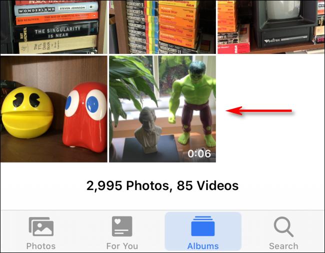 Toca un video en Fotos para seleccionarlo en iPhone